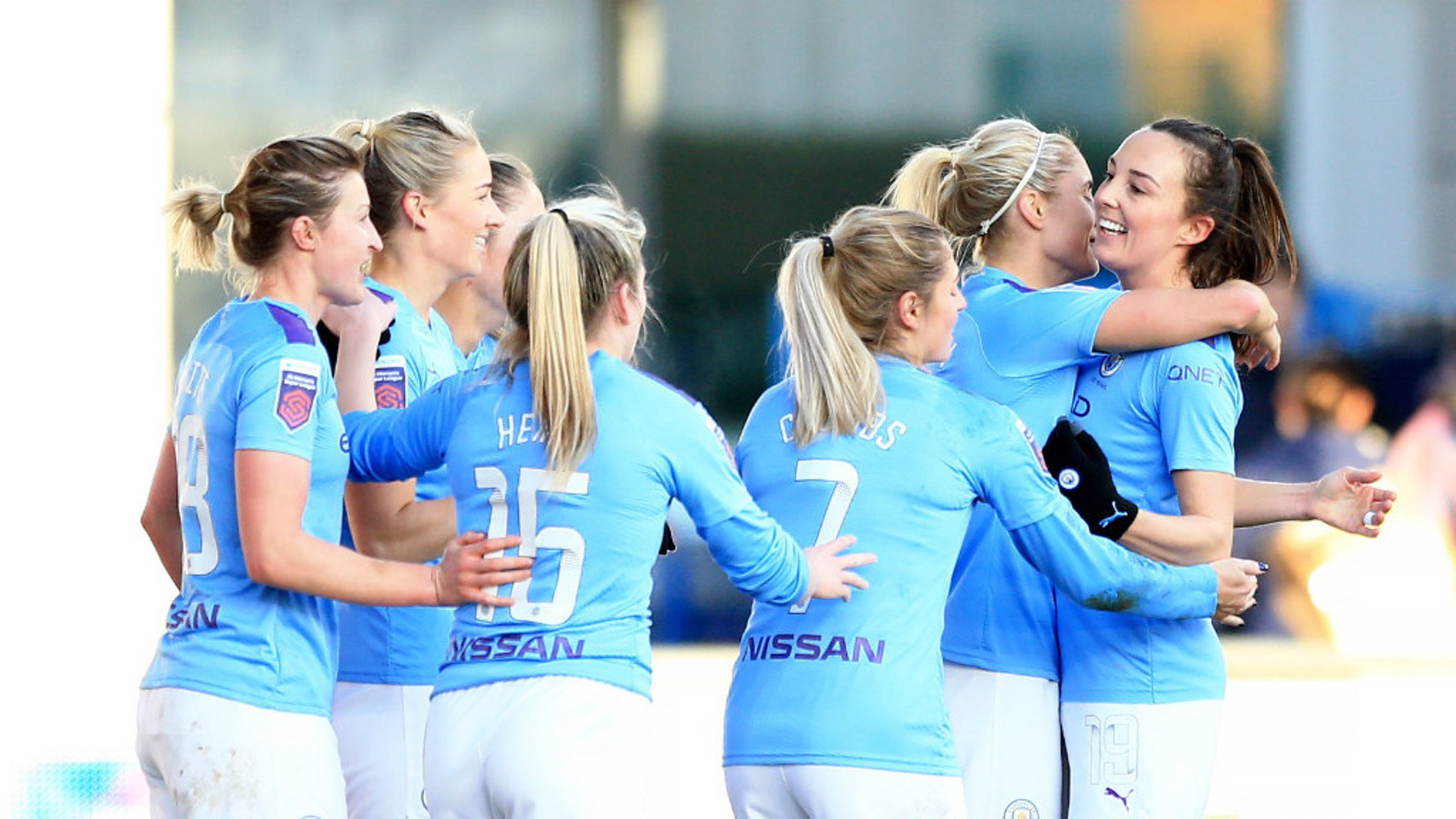 GET IN: Gemma Bonner is mobbed by her team-mates.