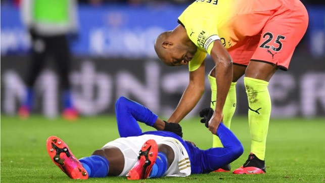 OUCH: Fernandinho checks on Kelechi Iheanacho after the striker was laid low by a collision with Ederson