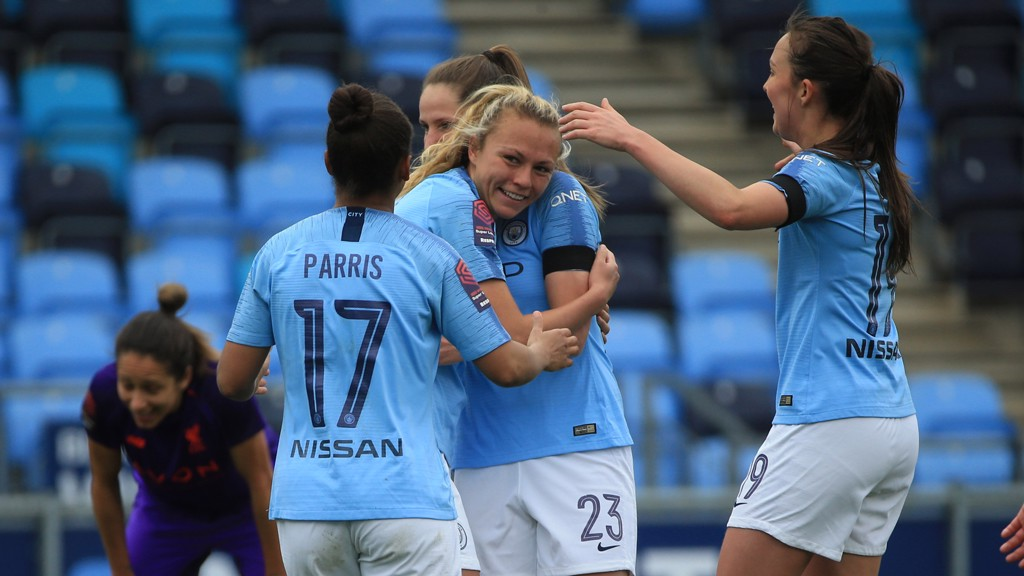 CELEBRATION TIME : Claire Emslie is greeted by her City team-mates after her first-half strike