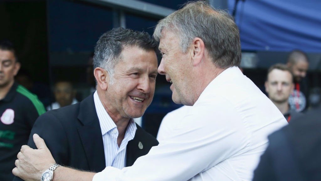 BLUE REUNION : Age Hareide greets Paraguay boss Juan Carlos Osorio, who spent five years in City's backroom staff