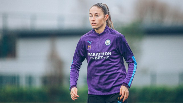 PURPLE REIGN : Janine Beckie shrugs off the rain as City hone their final preparations