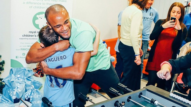 LITTLE AND LARGE : Kompany hugs a young fan while on hospital visit.