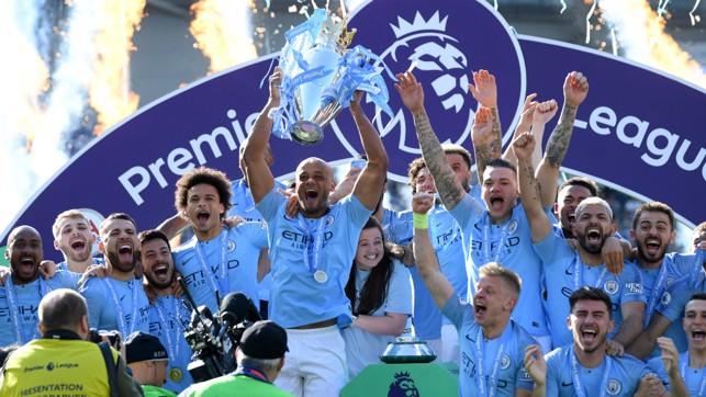 CHAMPIONS : Vincent Kompany lifts City's fourth Premier League trophy aloft