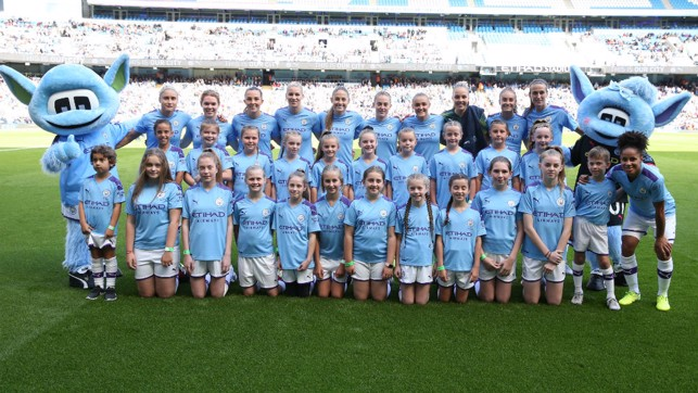 SQUAD GOALS : The City team and mascots line up ahead of kick-off