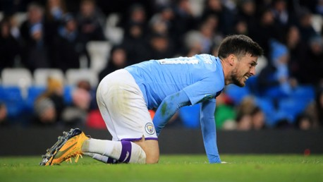 KNOCK: David Silva grimaces after a robust challenge from Angelo Ogbonna.