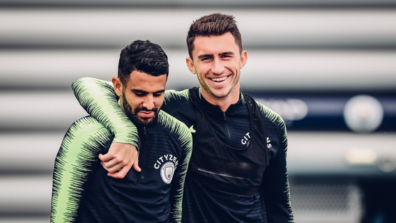 TEAM MATES: Mahrez and Laporte head out to the training pitches.