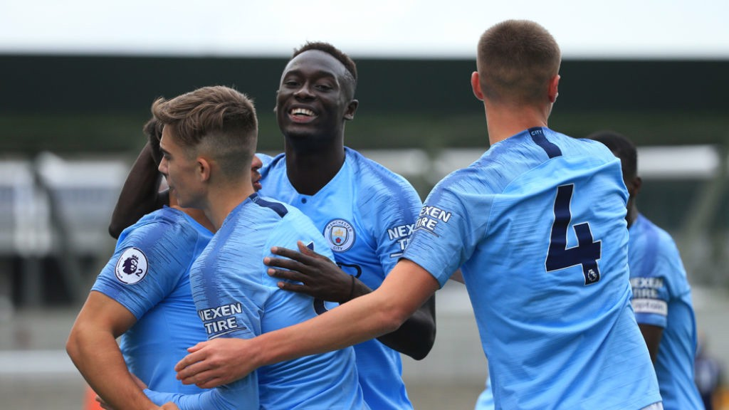 ALL SMILES : The City players celebrate after going 2-0 up against Derby