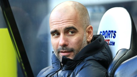 PRE-MATCH: Pep Guardiola takes his seat in the dugout.