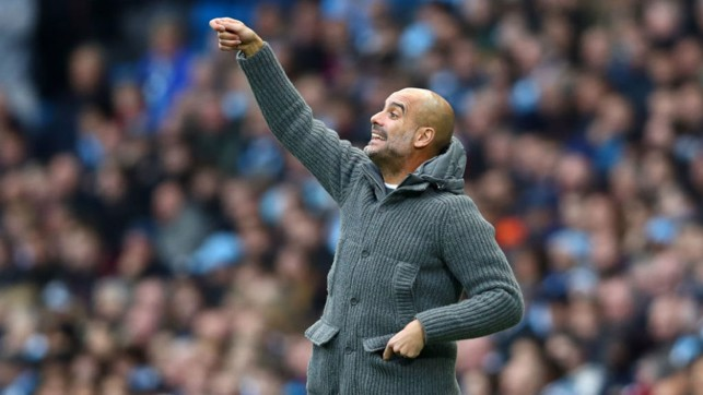 LEADING MAN : Pep Guardiola fires out some instructions to his players