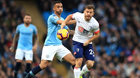 MY BALL: Danilo and Ryan Fraser battle for possession