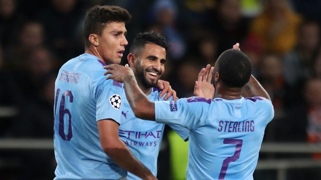 ALL SMILES : Riyad Mahrez celebrates after City's opener