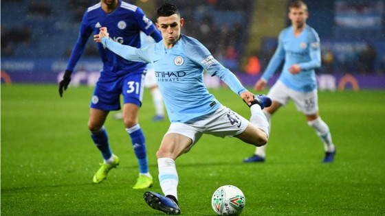 TEEN SPIRIT: Phil Foden peppers in a stinging shot as City turn up the pressure