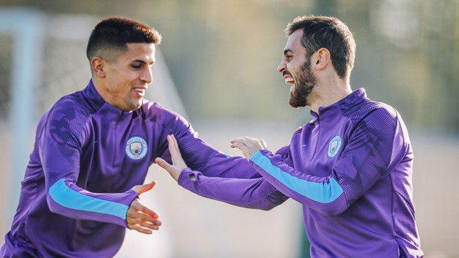 PORTUGUESE PALS : Joao Cancelo and Bernardo Silva share a joke