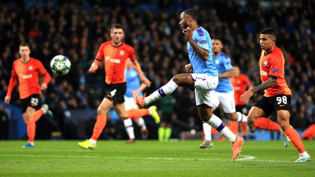 STERLING EFFORT : Raheem Sterling looks to clip the ball over Andriy Pyatov