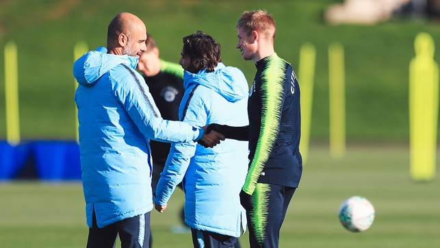SHAKE ON IT : Manager Pep Guardiola greets Kevin De Bruyne