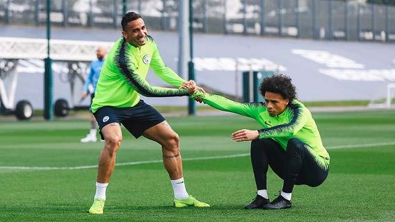 HELPING HAND: Danilo gets Leroy Sane back up onto his feet