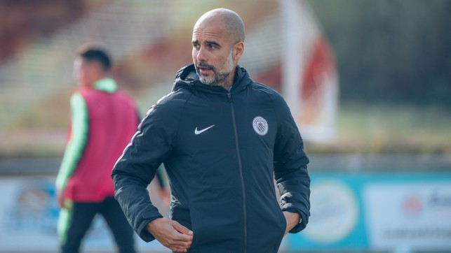 PLEASED AS PEP : The manager watches on