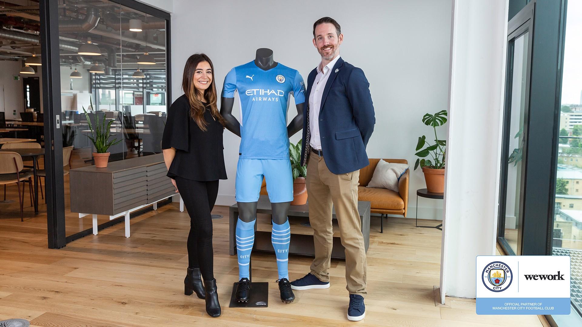 Tom Boyle, VP, Global Partnerships Marketing & Operations, City Football Group celebrates the new partnership with Amanda Zafiris, VP, Head of Marketing, International, WeWork.