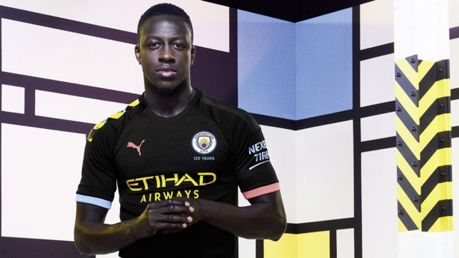FOCUSED : Benjamin Mendy looks the part in City new's PUMA away shirt