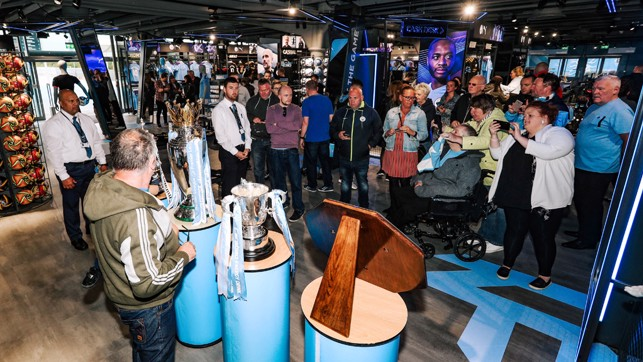 PICTURE PERFECT : Our fans were eager to check out the new-look store as well as being pictured with our trophies
