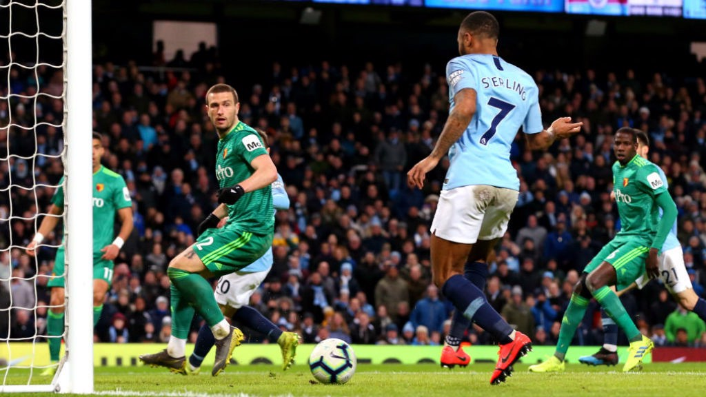 TWO'S COMPANY : Raheem slots home his and City's second goal after great work by David Silva and Riyad Mahrez