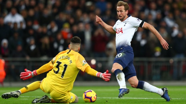 BLOCK : Ederson stops Harry Kane in his tracks as he charges towards goal.