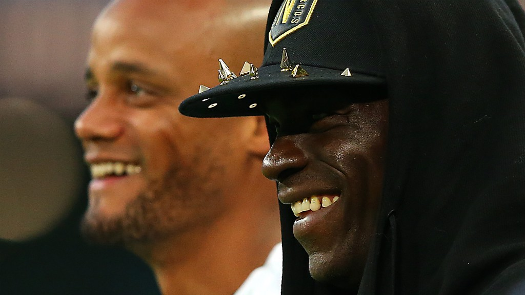 ALL SMILES : Mario Balotelli shares a few laughs with his old captain