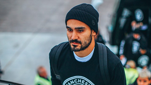 HATS THE WAY TO DO IT : Ilkay Gundogan had his game face on he boarded the plane