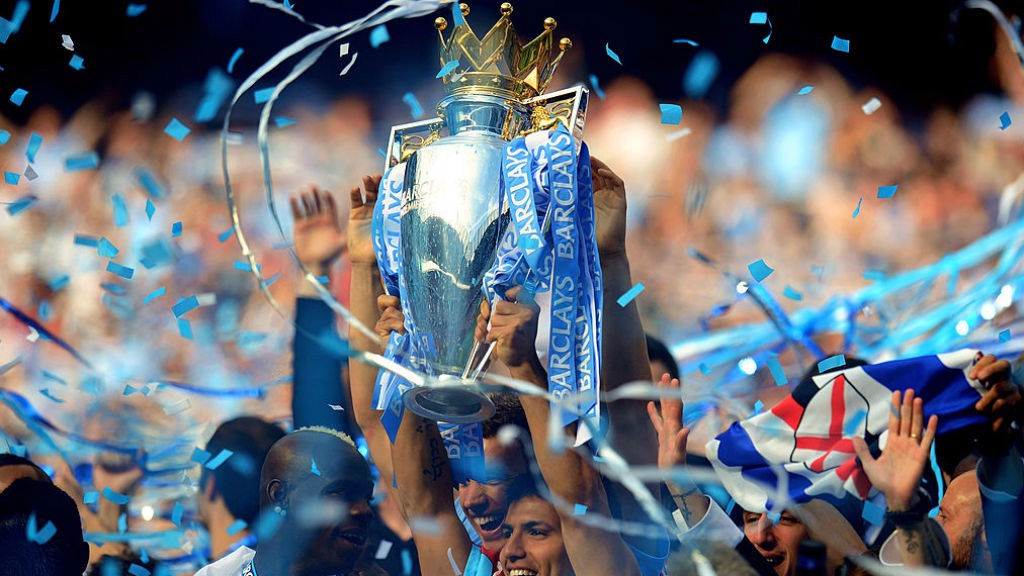 GLORY BOYS: Sergio lifts the Premier League trophy aloft