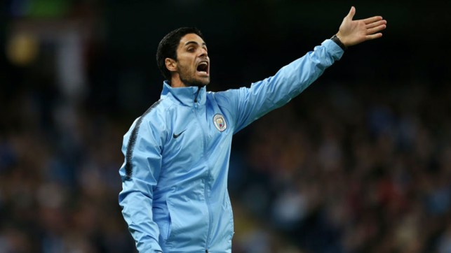 SHOUTING THE ODDS : Mikel Arteta passes on instructions to the City players