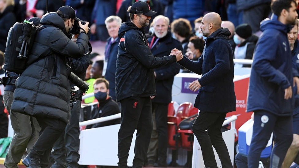 BOSSES : Klopp and Guardiola share a warm greeting on the touchline.