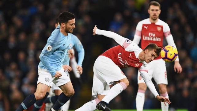 SPANISH WAR : David Silva and Denis Suarez battle in midfield.