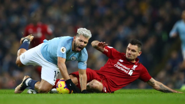 STOP START : Sergio Aguero is brought down by Dejan Lovren