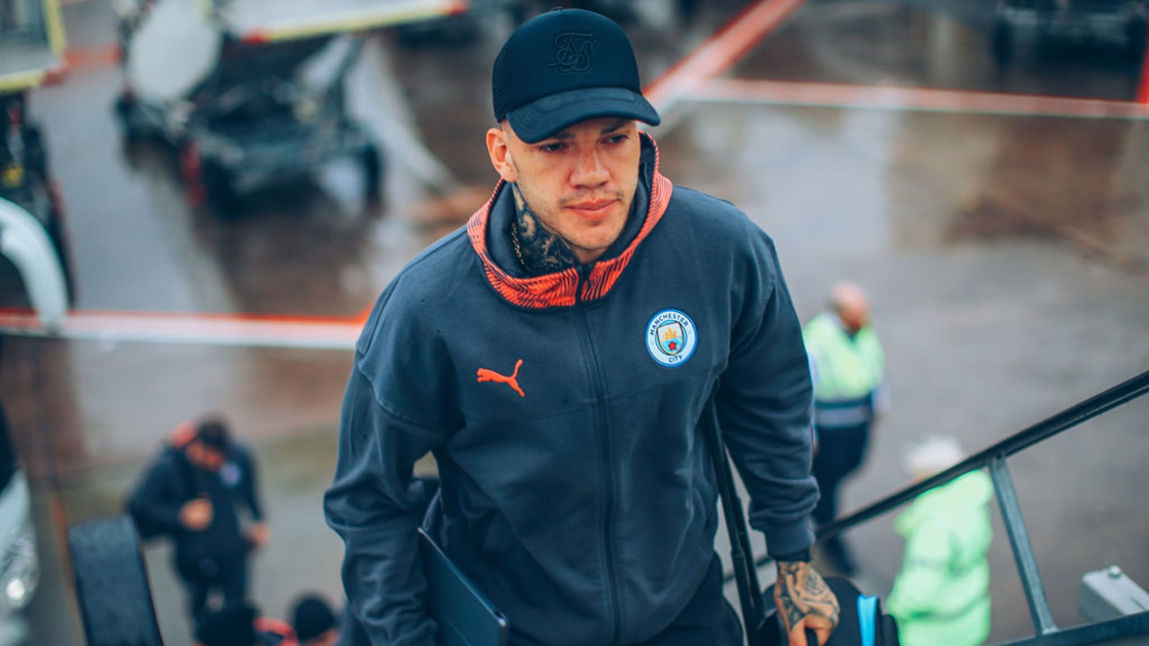 CAP THAT: Ederson sported a neat looking baseball cap as he boarded the aircraft