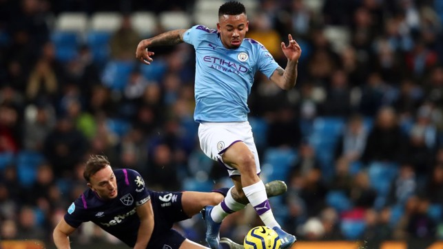 TRICKY : Jesus sprints away from Noble's challenge as City dominate the first period.
