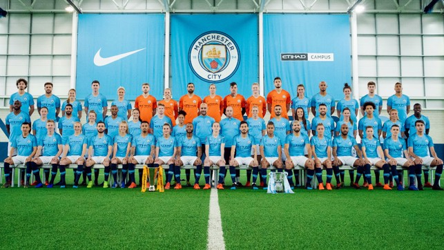 HISTORY MAKERS : Pep Guardiola and Nick Cushing line up alongside their two squads with the Continental and Carabao Cups proudly on display
