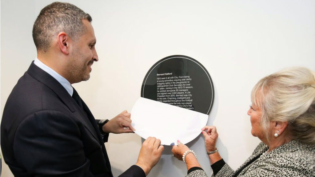 INFLUENCE WRIT LARGE : The chairman and Karen Halford unveil an inscription detailing Bernard's incredible impact on Manchester City
