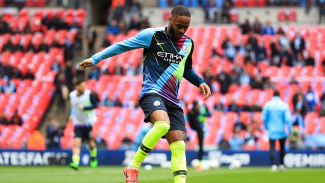 STERLING SILVER : Raheem sports the mash up of shirts which have seen us win six major trophies and counting.