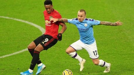 BATTLING: Angelino competes with Anthony Martial.