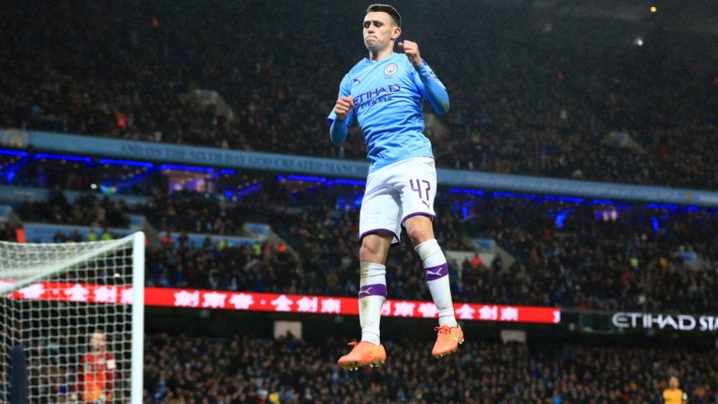 HIGH AND MIGHTY : Phil Foden celebrates what was a superb strike