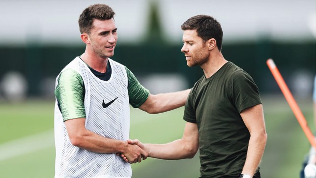 X FACTOR : Spanish legend Xabi Alonso, who played under Pep Guardiola at Bayern Munich was at the CFA today and here exchanges greetings with Aymeric Laporte