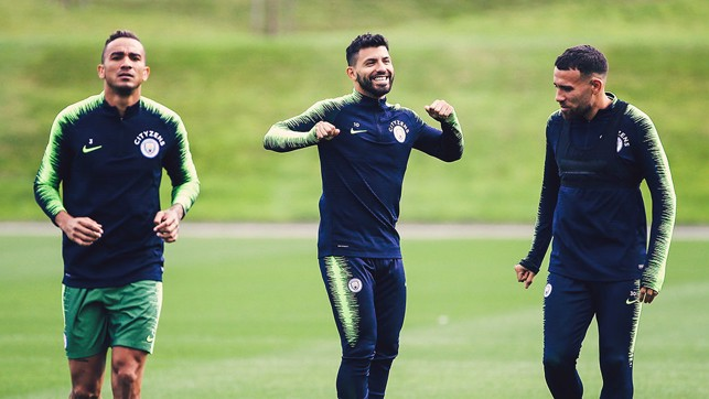 CENTRE OF ATTENTION : Sergio Aguero is all smiles alongside Danilo and Nicolas Otamendi