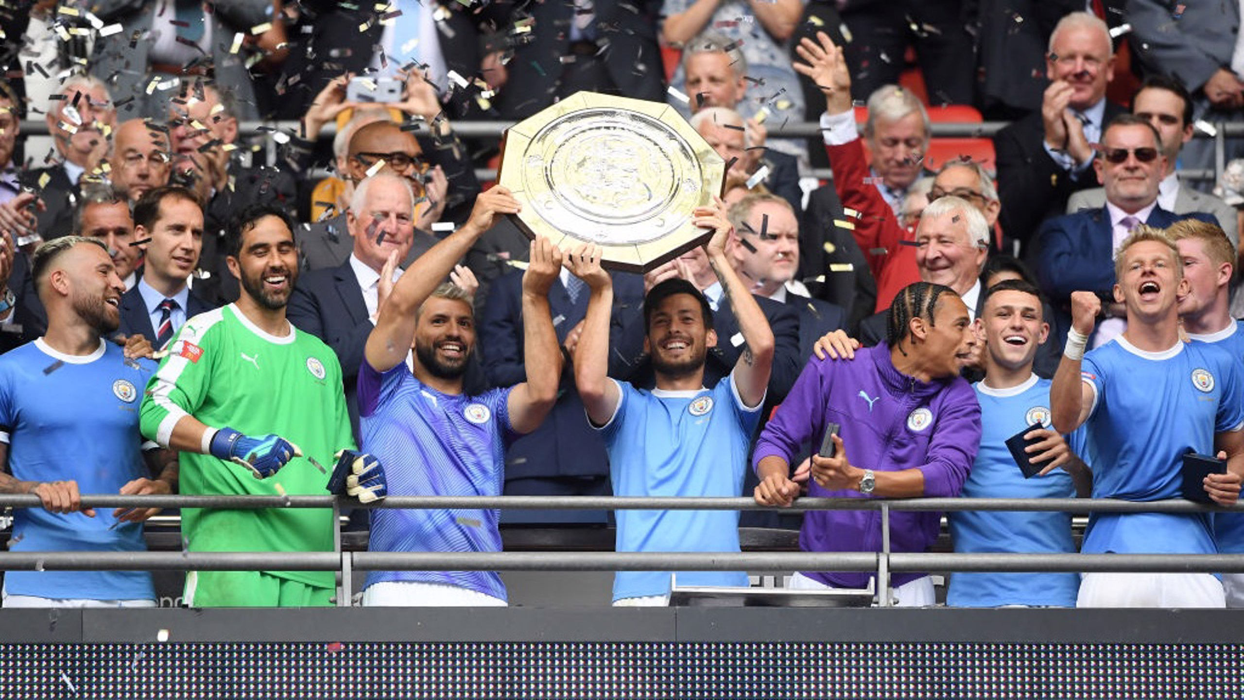 SUPERSTARS: David Silva and Sergio Aguero lift the Community Shield.
