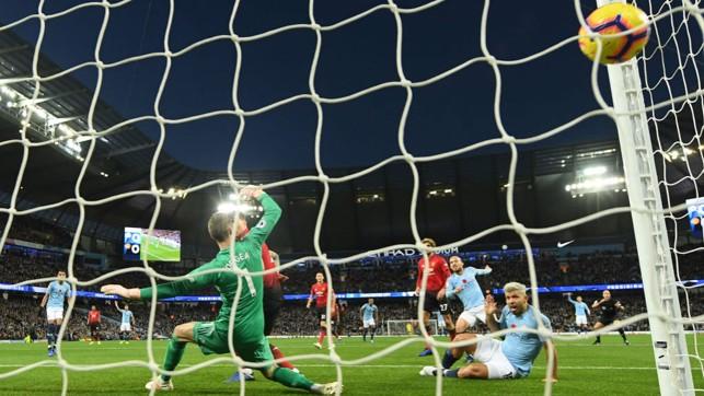 NET GAIN : David Silva's shot nestles in the back of the United goal.