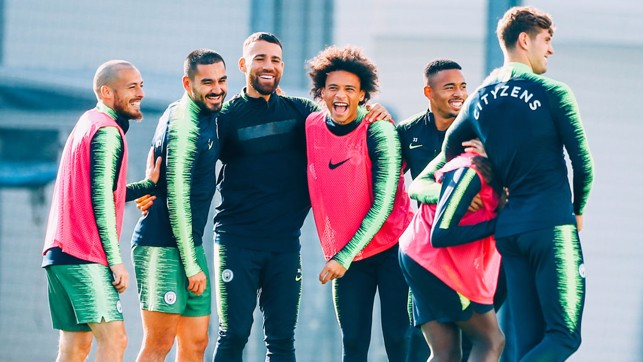 FEELING GOOD : The squad smile in the Manchester sun