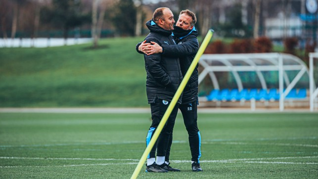 A FOND FAREWELL : Assistant manager Alan Mahon embraces the boss ahead of Saturday's session