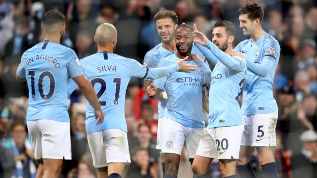 HIGH FIVES : Raheem Sterling takes the plaudits from his City team-mates after scoring our fifth goal