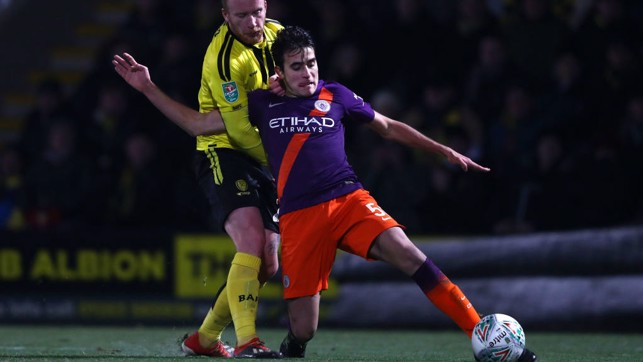 CLEARING THE DANGER : Eric Garcia stops a Burton attack with a timely interception
