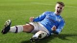 SLIDE RULE: Liam Delap gets the celebrations started
