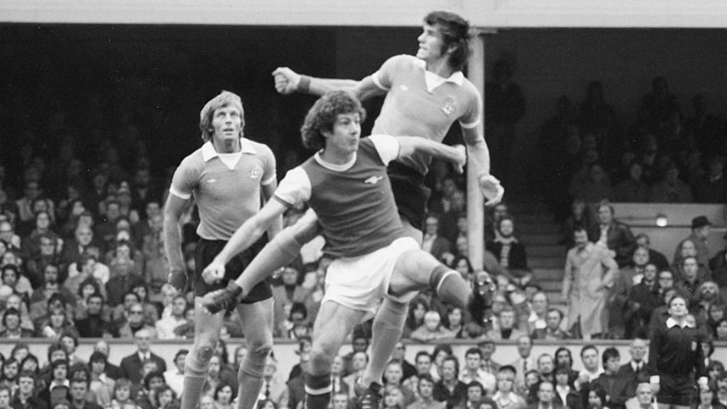 ACTION MAN: Brian, during his time at Arsenal, challenges City's Dave Watson in a game in 1975